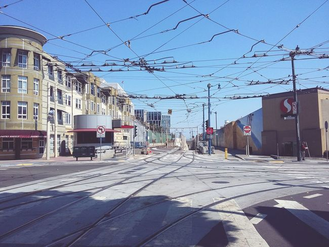 Power Lines and Shade at Church and Duboce. · San Francisco SF California CA USA City Scene Urban Landsape Public Transportation Traffic Intersection Busyness Sunny Day Blue Sky
