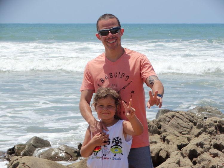 EyeEmNewHere Fatheranddaughter Happy Itapuãbeach Salvador Bahia Brazil EyeEm Selects Beach Sea Looking At Camera Portrait Child Vacations First Eyeem Photo