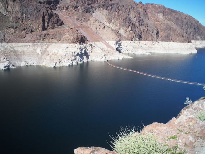 A View From Hoover Dam facing north looking towards Lake Mead limescale on the Rocks over a hundred feet Low Water Line Lake Mead Limescale On The Rocks A Hundred Feet Lake Mead Water Reservoir Nature Beauty In Nature No People Scenics Water Mountain Tranquility Tranquil Scene Day Outdoors Sky