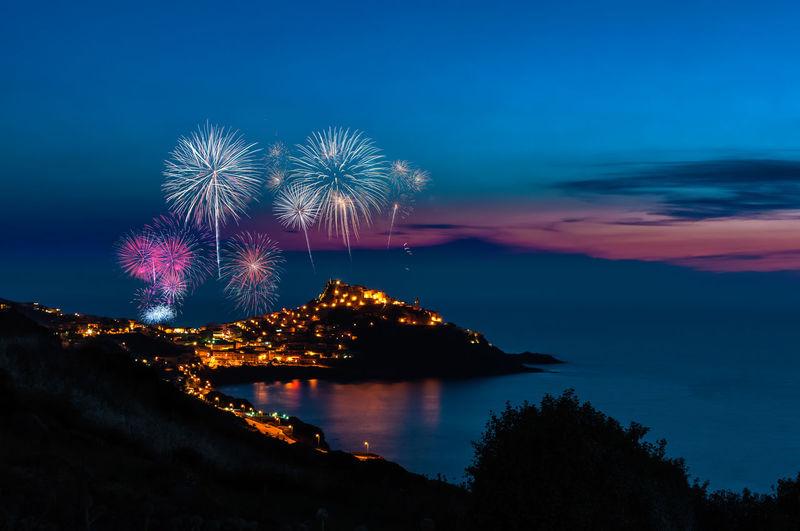 Landscape of city of castelsardo by night with fireworks