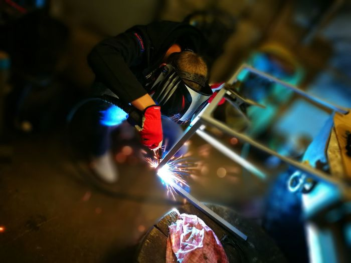 High angle view of welder welding in workshop