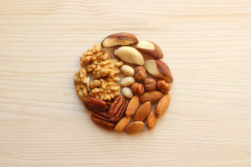 variety of nuts forming a circle Brazil Nut Bright Circle Copy Space Pecan Wood Backgrounds Brown Close-up Directly Above Fat Food Food And Drink Hazelnut Healthy Eating Heap Indoors  Macadamia No People Nut - Food Round Shape Unsaturated Variation Variety Walnut