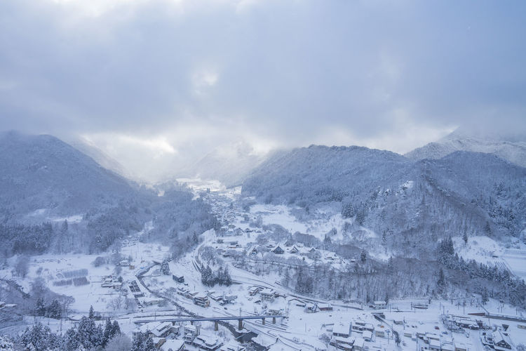 Winter Snow Cold Temperature Mountain Cloud - Sky Environment Scenics - Nature Landscape Nature City Sky No People Beauty In Nature Travel Architecture Day Outdoors Mountain Range Travel Destinations Snowing Snowcapped Mountain Range
