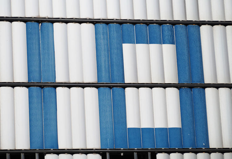 Number ten in blue and white metal panels