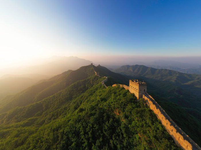 Summer Great Wall Sunrise History Architecture History Building Exterior Plant Copy Space Idyllic Non-urban Scene Mountain Range Tree High Angle View No People Environment Tranquility Tranquil Scene Scenics - Nature Sky Sunlight Sunrise Mountain Travel Destinations Travel China Culture Landmark Beijing Landscape Summer Outdoors Beauty In Nature Nature Architecture China Great Wall Of China Tower Great Wall Great Wall Of China