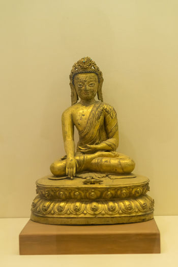 Sculpture Art And Craft Representation Statue Human Representation Male Likeness Creativity Belief Spirituality Religion Craft No People Indoors  Architecture Gold Colored Idol Wall - Building Feature Built Structure