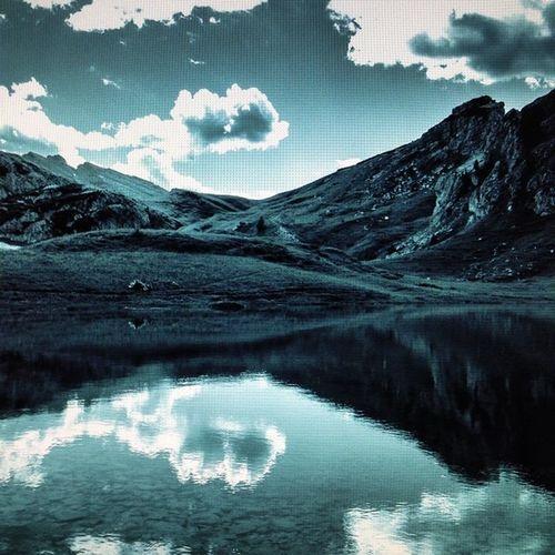 Shot 694 -the last for today. A dreamy interpretation of Lago #Valparola (screenshot) #dolomites #alps #alpinelake #lightroom #lifeisbeautiful #lifelessordinary #clouds #italy #reflections #iphonography