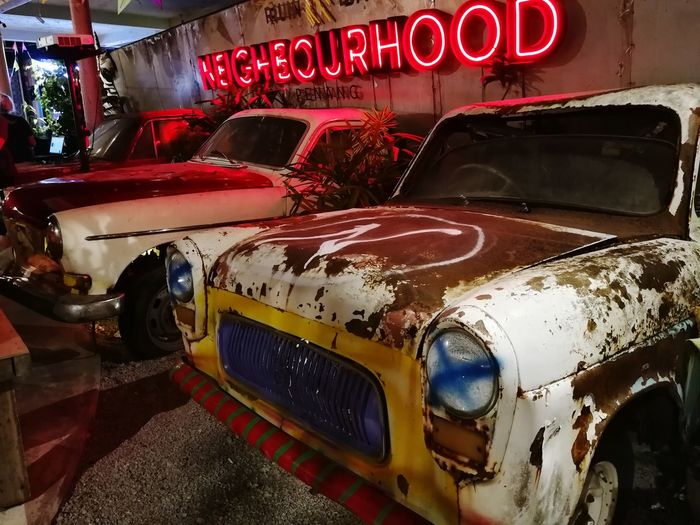 neibourhood Red Communication Car Text Land Vehicle Vehicle Light Windshield Tail Light Vintage Car Collector's Car Headlight Capital Letter Western Script Information Information Sign