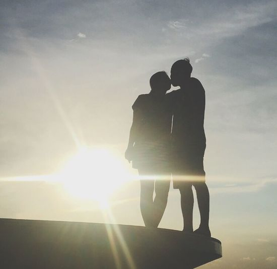 """""""And the sunlight clasps the earth And the moonbeams kiss the sea: What is all this sweet work worth If thou kiss not me?"""" Percy Bysshe Shelley Love's Philosophy The Week On EyeEm Sunset Kiss Sunset Kiss Couple Silhouette Two People Sunlight Sky Outdoors Nature Eyeem Philippines"""