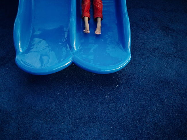 Blue Low Section Human Leg Human Body Part People Space Close-up One Person Day Playground Slide Feet Play Eyeem Philippines Kid Minimalism Minimal Break The Mold The Street Photographer - 2017 EyeEm Awards Live For The Story