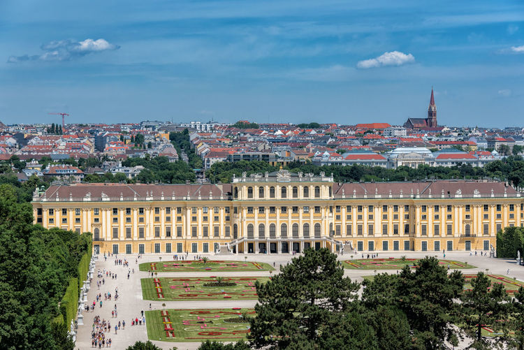 Schloss Schönbrunn Architecture Building Exterior Built Structure Capital Cities  City City Life Cityscape Cloud Cloud - Sky Cloudy Day Elevated View Green Color Growth No People Outdoors Residential Building Residential District Residential Structure Sky Tourism Town TOWNSCAPE Travel Destinations Tree