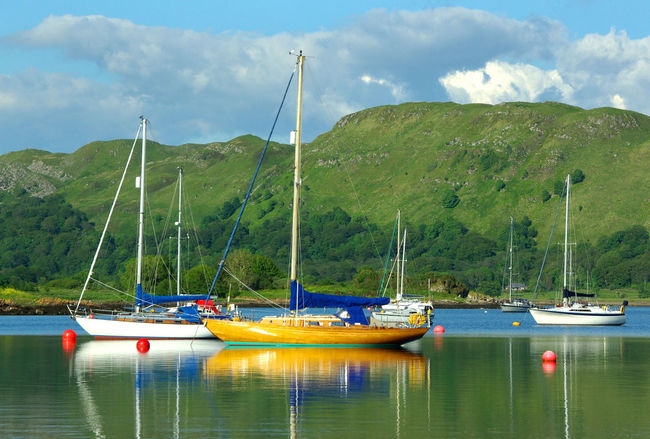 Yacht Reflections Ardfern Argyll Beauty In Nature Cloud - Sky Day Marina Mast Mode Of Transport Moored Mountain Nature Nautical Vessel No People Outdoors Reflections In The Water Sailboat Scenics Sky Tranquil Scene Tranquility Transportation Tree Water Yachting Yachts At Anchor