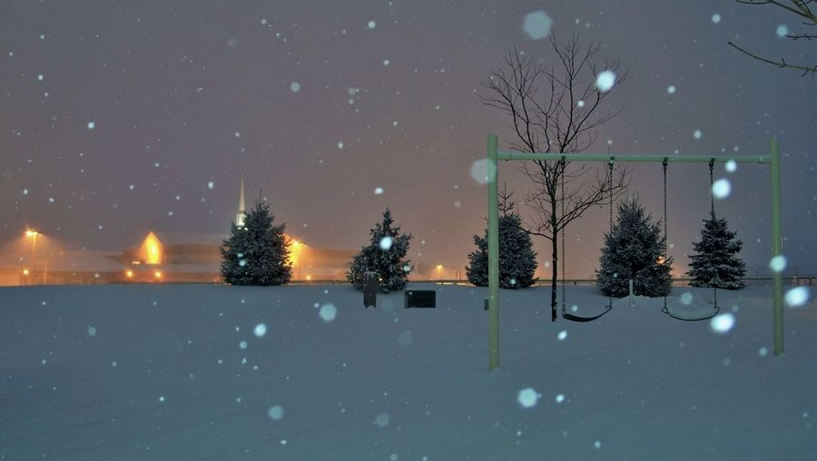 Scenic View Of Snow Covered Playground At Night