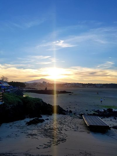 Sun is going down on the beach EyeEm Gallery Summertime JEJU ISLAND  Sunset Beach Reflection Sky Horizon Over Water Cloud - Sky Landscape Low Tide Shore