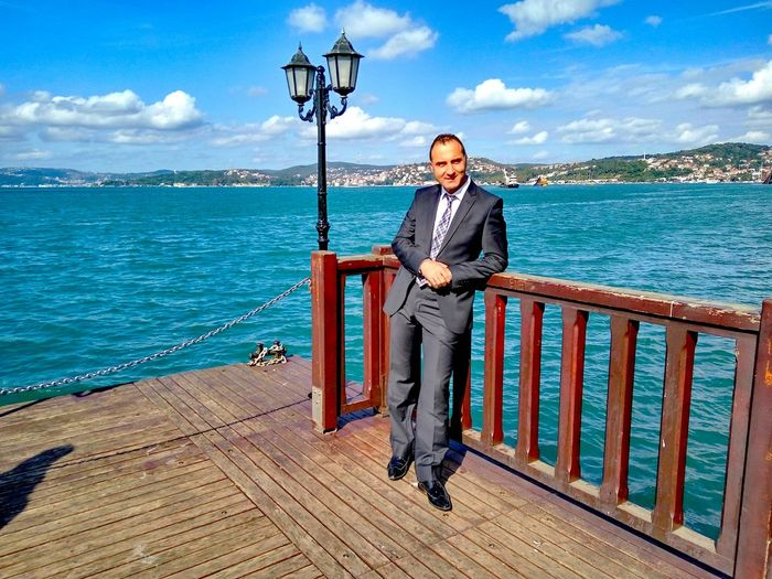 Man In Suit By The Sea