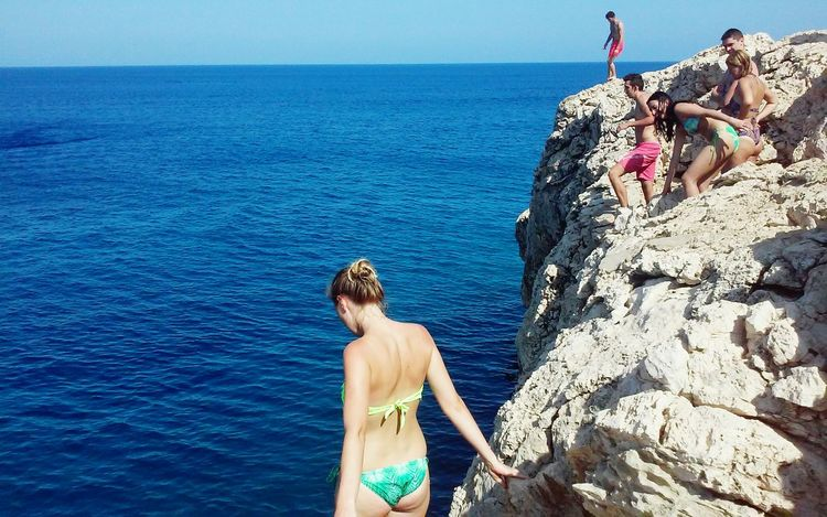 Sky Cliff Diving Rocks And Water Rocks Cliff Adventure Island Cliff Jumping Sea People Woman In Bikini Looking At The Sea Summer Fun Jumping Blue Horizon Over Water Boat Blue Sky Cyprus Adventure Club
