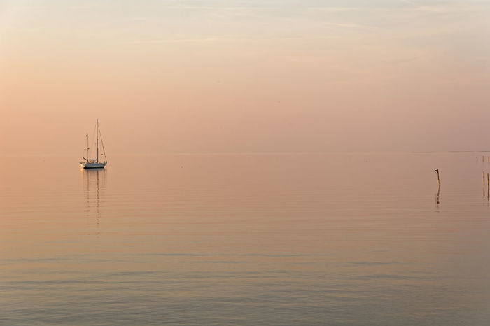 The Silent Dawn Beauty In Nature Horizon Over Water Idyllic Mode Of Transportation Nature Nautical Vessel No People Non-urban Scene Outdoors Reflection Sailboat Sailing Scenics - Nature Sea Sky Sunset Tranquil Scene Tranquility Transportation Water Waterfront Yacht
