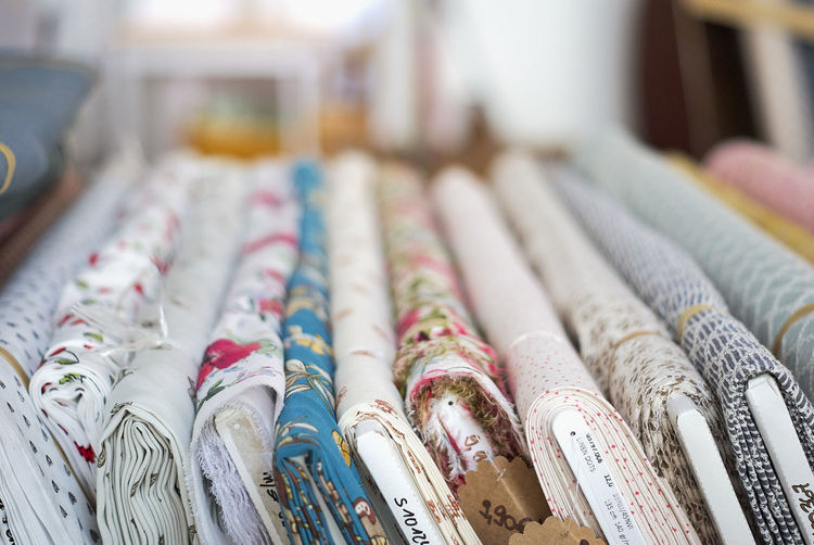 Close-up of rolled up textile in store