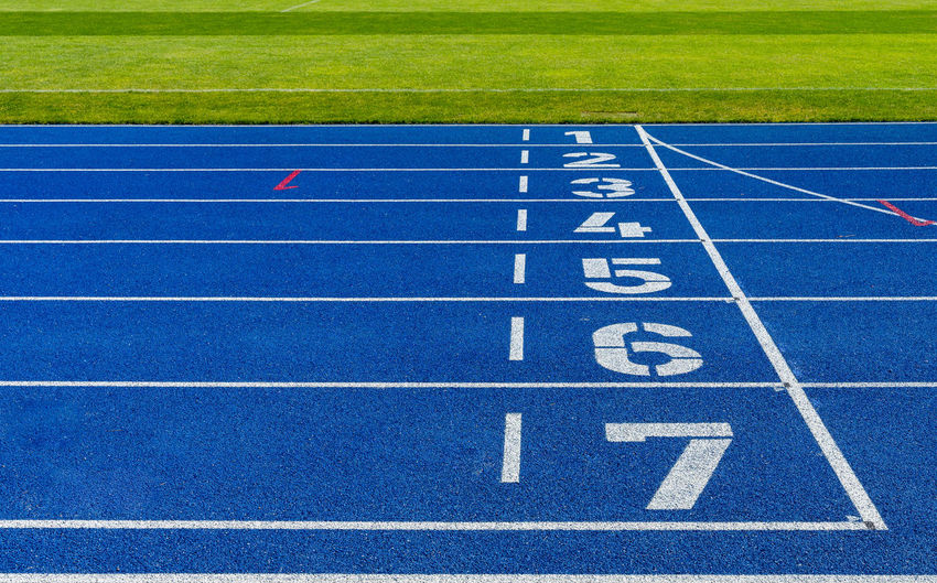 Teamwork Team Target Objective Lines Lines And Shapes Teamspirit Teamsport Finish Line  Starting Line Numbers Number End Finish Winner Sport Track And Field Running Track Day Competition No People Blue Sports Track Absence Stadium Sports Race Track And Field Event Outdoors Nature Grass White Color