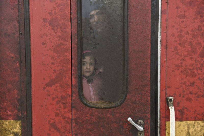 The train departed from Sid Serbia, arrived at Slavonski Brod, Croatia on Feb. 04, 2016. A father and daughter are waiting for the door open in the train. Croatia Daughter Father Red Refugees Slavonski Brod The Photojournalist - 20I6 EyeEm Awards Train First Eyeem Photo