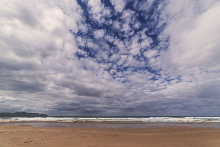Summer days on Benone Beach in County Londonderry Beach Beauty In Nature Benone Beach Benone Strand Castlerock Cloud - Sky County Londonderry Day Horizon Over Water Ireland Nature No People Northern Ireland Tourism Outdoors Sand Scenics Sea Shore Sky Sommergefühle Water Wave