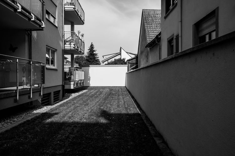 Hinterhof ... Urban Perspectives Street Photography Black & White Monochrome Black And White Architecture Built Structure Building Exterior Building City Sky Day Direction Residential District No People The Way Forward Outdoors House Diminishing Perspective Wall - Building Feature Empty Plant Alley Backyard