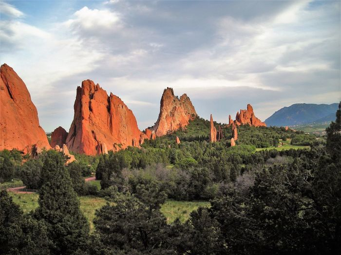 Garden of the Gods Cloud - Sky Sky Beauty In Nature Scenics - Nature Rock Environment Rock Formation Mountain Landscape Non-urban Scene Nature Tranquil Scene Rock - Object No People Tranquility Plant Geology Solid Physical Geography Travel Destinations Mountain Range Formation Arid Climate Eroded Garden Of The Gods