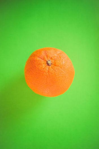 Close-up of orange over black background
