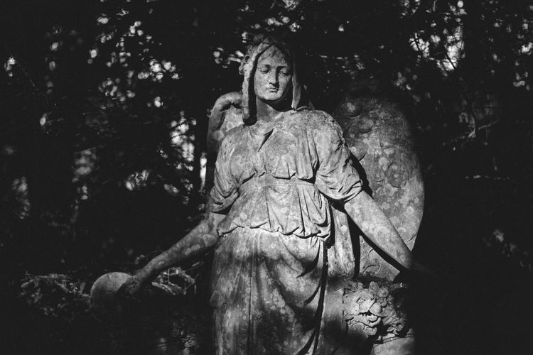 Old angel statue in cemetery