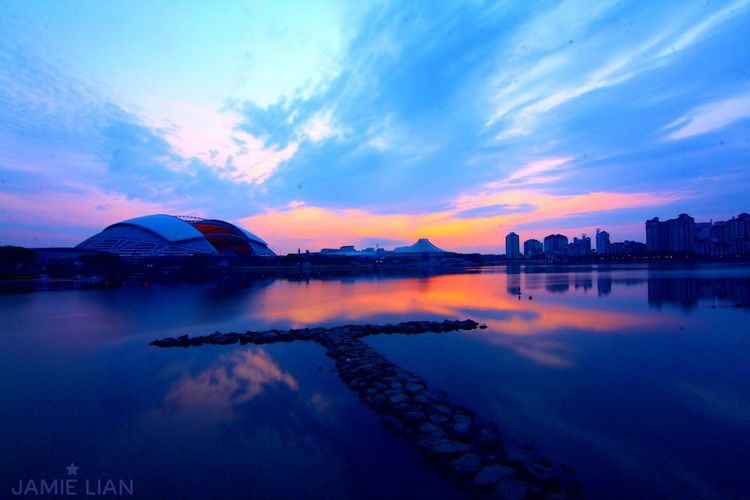 SportsHub 🇸🇬 Cloud - Sky Reflection Sunrise Blue Beauty In Nature Dramatic Sky Vibrant Color Sky Water Tranquil Scene Waterfront Outdoors Sunset Water Scenics Reflection Tranquil Scene Sky Tranquility Beauty In Nature Waterfront Blue Cloud - Sky Idyllic Orange Color First Eyeem Photo