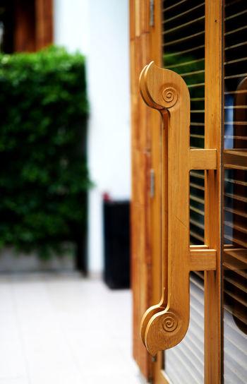 Close-up of door handle on building