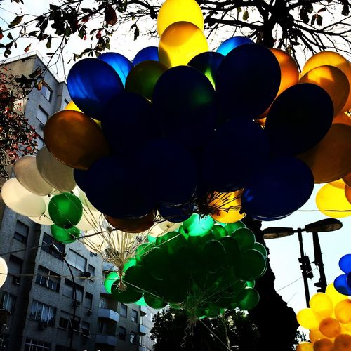 Low angle view of multi colored balloons