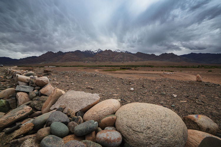 Scenic view of rocks on field against sky