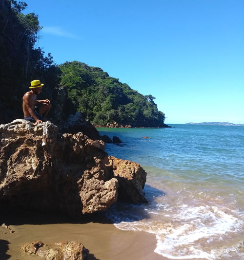 Buzios Happy Rio De Janeiro Rocky Sitting Vacations Wave Bearded Beauty In Nature Blue Carioca Day Jumping Leisure Activity Lifestyles Motion Photography One Person Outdoors Real People Sand Sea Sky Water Waterfront Summer Exploratorium This Is Latin America