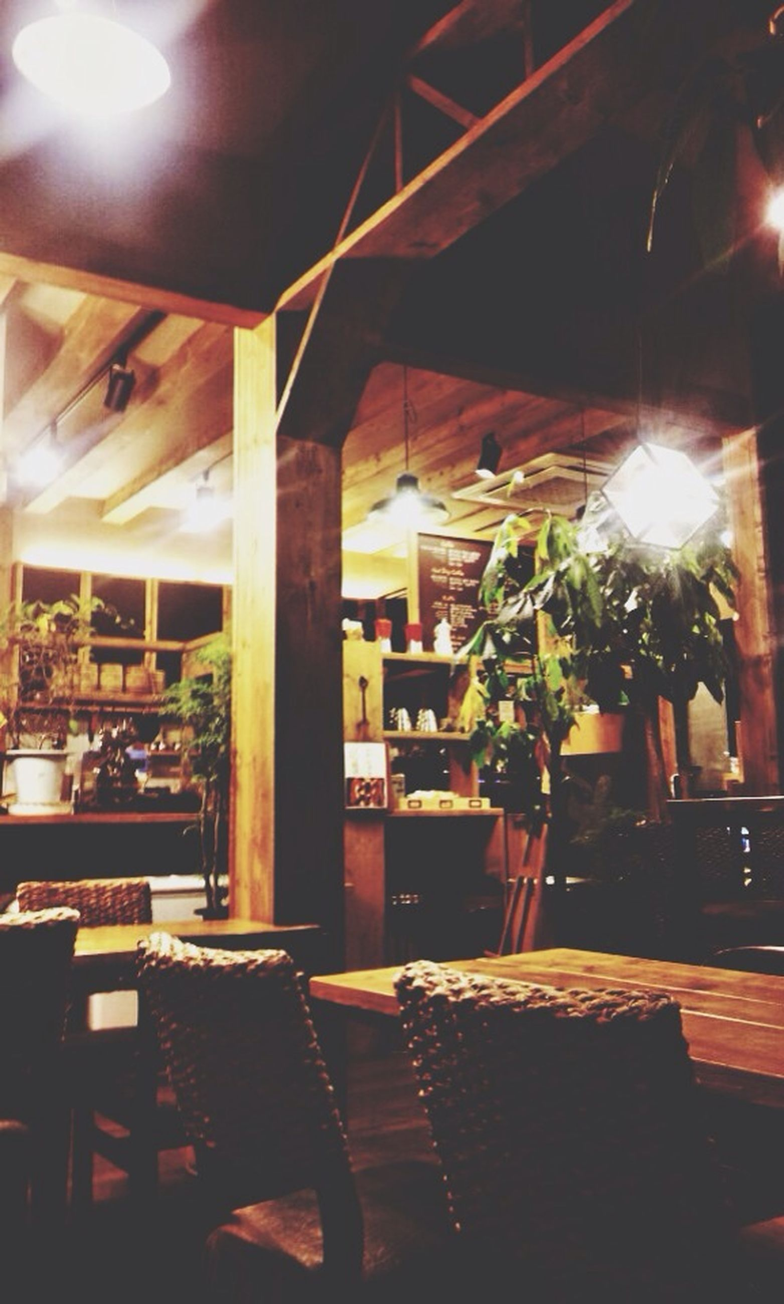 indoors, illuminated, table, chair, built structure, architecture, night, restaurant, lighting equipment, absence, potted plant, sunlight, window, home interior, building exterior, empty, house, incidental people, no people, electric lamp
