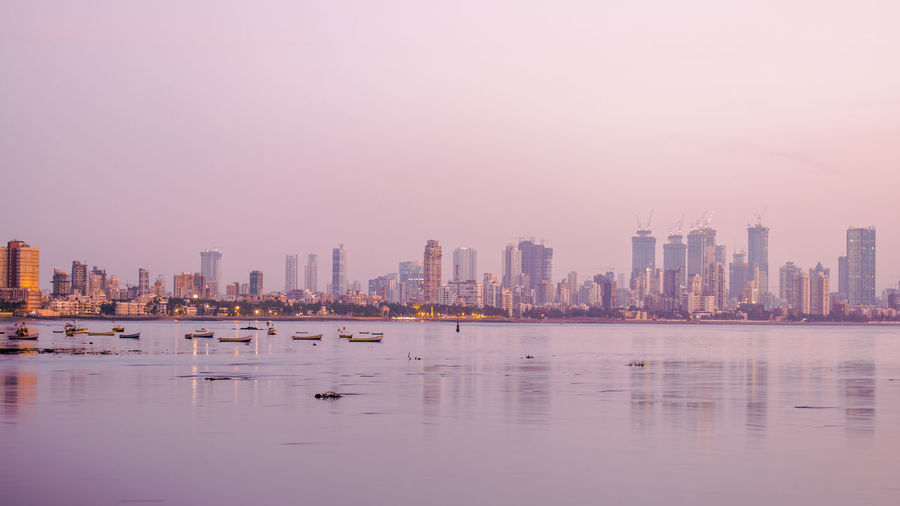 Cityscapes in Color - Mumbai, India Pink Sky Sunset Silhouettes Sunset_collection Architecture Boat Building Built Structure Cityscape Evening Sky Landscape Nature No People Outdoors Reflection Sea Sea View Seascape Sunset Tower Urban Landscape Urban Skyline Waterfront