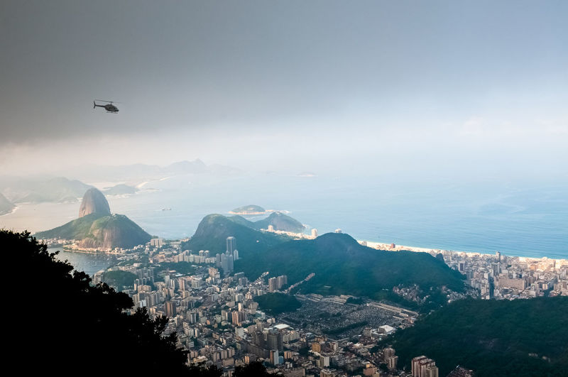 Rio de janeiro from the top of the mountain. flying helicopter and sugarloaf mountain