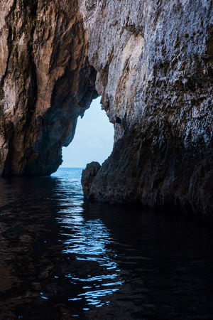 View from inside the Blue Grotto sea cave in Malta Blue Grotto Blue Grotto Cave Entrance Exploring Limestone Cave Malta Natural Arch Arch Beauty In Nature Boat Trip Cave Cavern Caves Day Grotto Gulf Limestone Littoral Littoral Cave Nature Scenics Sea Sea Cave Sea Water Tranquility
