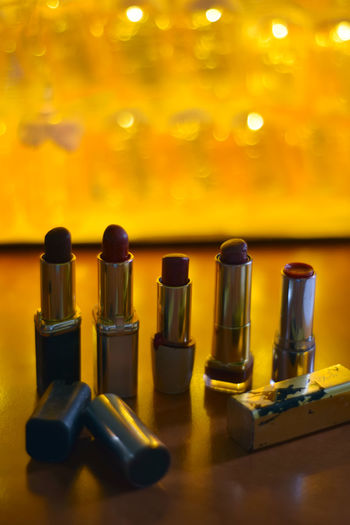 Close-up of lipsticks on table