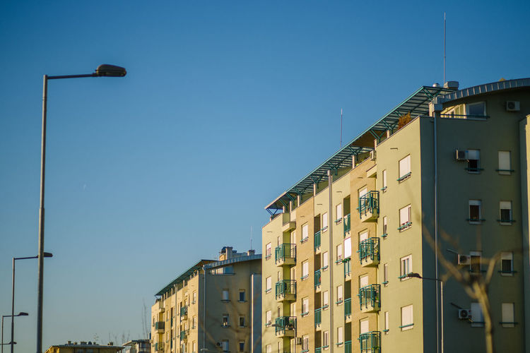 Low angle view of residential buildings against clear sky
