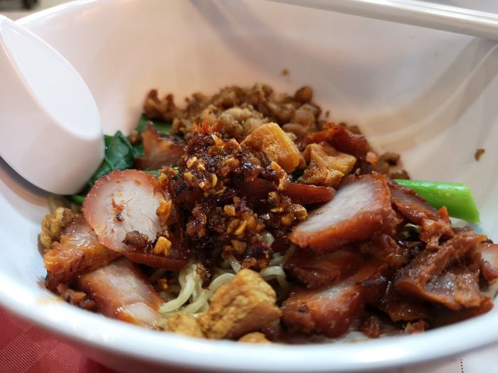 High angle view of singaporean minch meat noodles served in plate