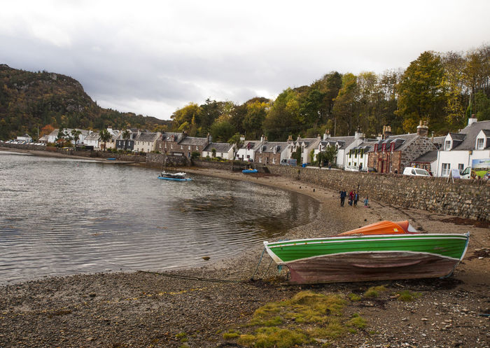 Plockton (Am Ploc/Ploc Loch Aillse in Gaelic) is a village in the Highlands of Scotland in the county of Ross and Cromarty with a population of 378. Plockton is a settlement on the shores of Loch Carron. It faces east, away from the prevailing winds, which together with the North Atlantic Drift gives it a mild climate allowing the Cordyline australis palm or cabbage tree to prosper. Loch Carron Architecture Beach Cherry Blossoms Cloud - Sky Day Highlands Of Scotland Horizontal No People Outdoors Palm Tree Plockton Ross And Cromarty Scotland 💕 Sky Tourism Tourist Tourist Attraction  Travel Destinations Traveling Tree Vivid International Water