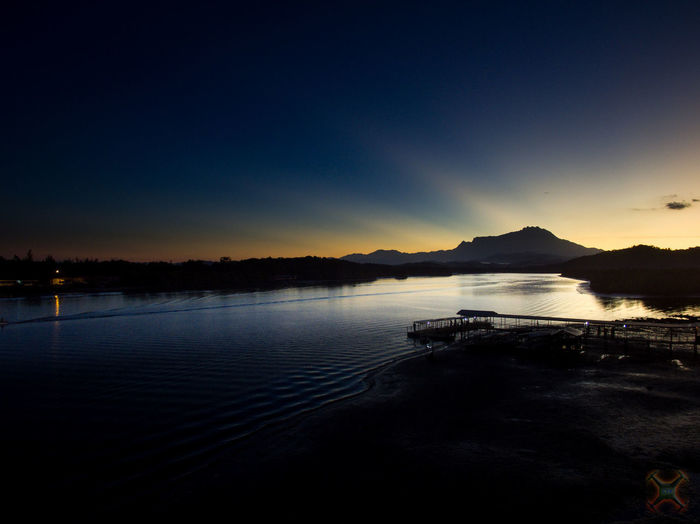 Sunrise view of Mount Kinabalu from Mengkabong Bridge, Sabah, Malaysia. Beauty In Nature Blue Clear Sky Lake Mengkabong River Mount Kinabalu Mountain Nature Nautical Vessel Night No People Outdoors Scenics Silhouette Sky Sunset Tranquil Scene Tranquility Tuaran Water