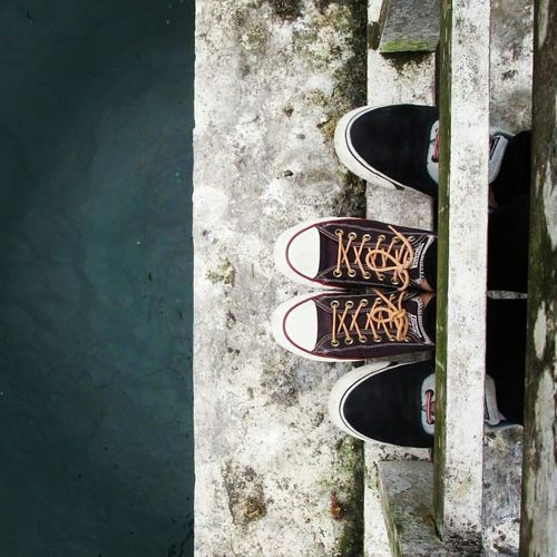 Overhead View Of Feet On Bridge