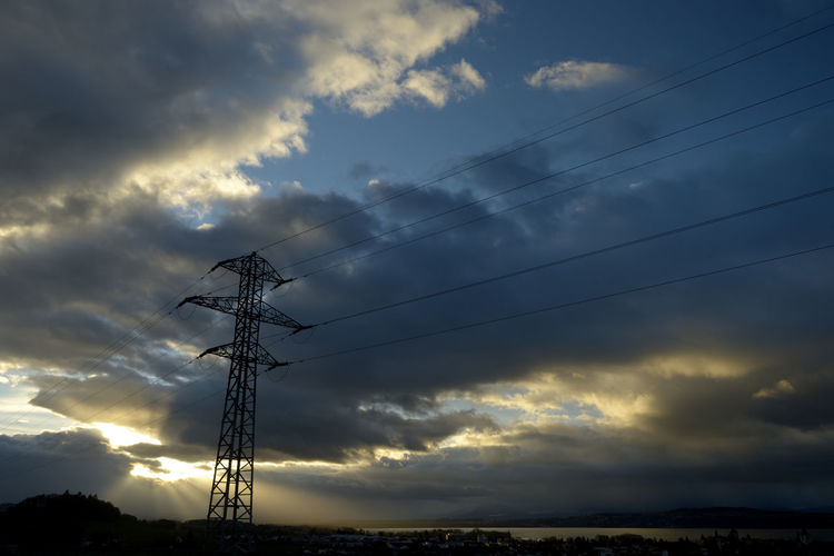 Sky Cloud - Sky Clouds And Sky Bluesky Technology Electricity  Cable Electricity Pylon Power Line  Connection Fuel And Power Generation Low Angle View Power Supply Sunset Nature No People Beauty In Nature Dramatic Sky Scenics - Nature Outdoors Silhouette Complexity Electrical Equipment