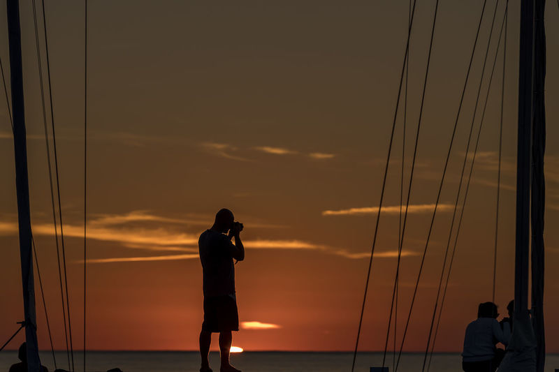 Sweden Beauty In Nature Byxelkrok Camera - Photographic Equipment Horizon Over Water Leisure Activity Lifestyles Men Nature Outdoors People Photographing Photography Themes Real People Scenics Sea Silhouette Sky Standing Sunset Technology Water Women Young Adult Young Women