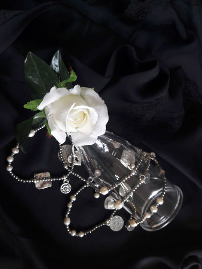 """Purity"" Luxury Jewelry Fragility Flower Rosé White Rose Purity Pureness Chastity Concept Conceptual Close Up White Black Silver  Black And White Pearls White Pearls Silk Lace Black Silk Social Black Background No People Femininity EyeEmNewHere EyeEm Selects"