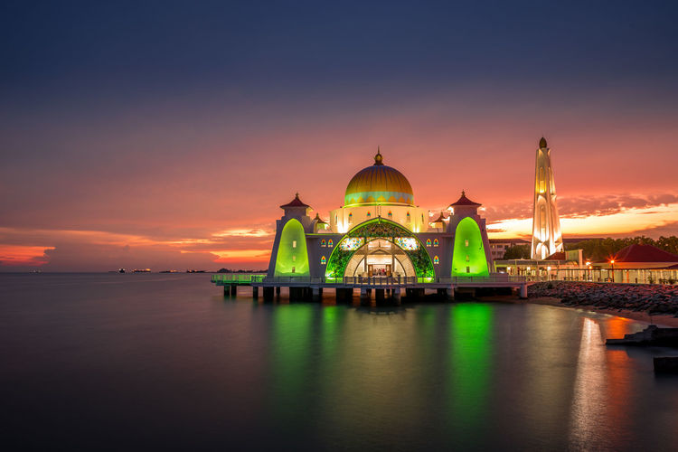 Melaka Melaka Heritage City Architecture Belief Building Building Exterior Built Structure Cloud - Sky Dome Government Illuminated Malacca Mosque Nature No People Place Of Worship Religion Sky Spirituality Sunset Tourism Travel Travel Destinations Water Waterfront