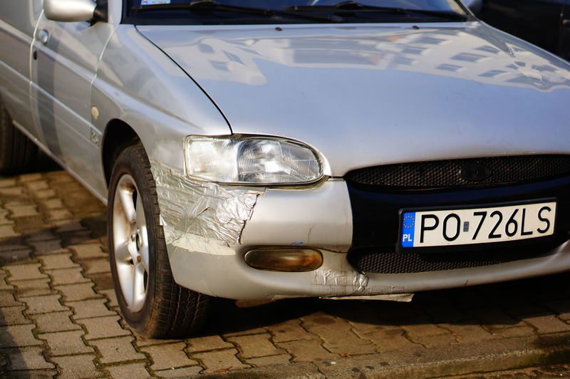Close-up of car parked on street
