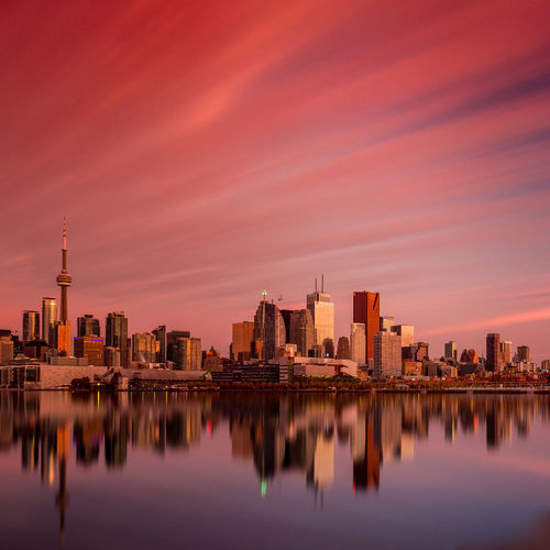 8 min exposure this morning of the sunrise coming up in the city of Toronto. Jasoncrockettphotography Long Exposure Clouds And Sky Cityscapes Downtown Toronto Cntower Buildings Landscape Water Reflections